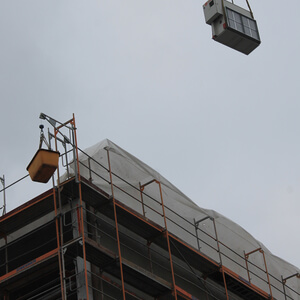 "The cooling unit ""floats"" above the new building towards its future location…"