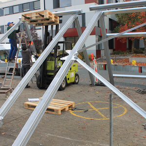 The frame for the ventilation system is assembled on the car park in front of DIATEST…