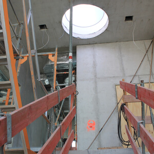 A circular roof window on the fourth level brings lots of light into the staircase.