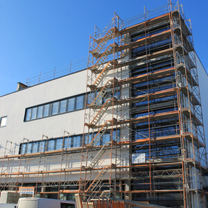 The scaffolding is partly removed from the building…